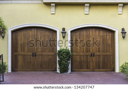 Two car wooden arch garage in South Florida - stock photo