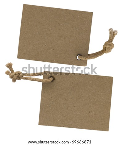 two cardboard corrugated paper labels with strings isolated on the white background - stock photo