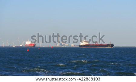 Two cargo ships sailing from the port of Antwerpen - stock photo