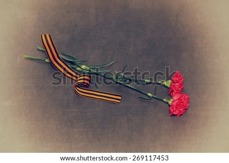 Two carnation flowers and George Ribbon. In honor of the victory in World War II - stock photo