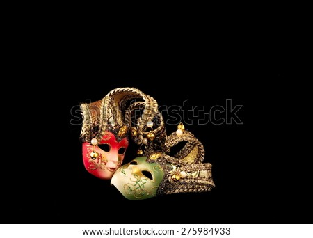 two carnival masks on a black background - stock photo