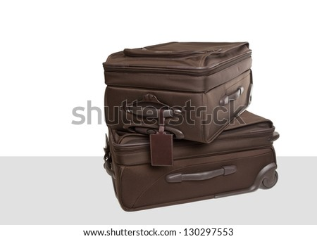 Two carry-on suitcases - stock photo