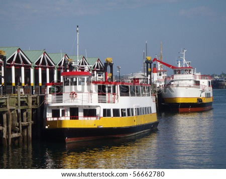 Two Casco Bay Ferries in the harbor of Portland Maine.  The Ferries are steel-hulled diesel-powered vessels with high-tech navigation systems - stock photo