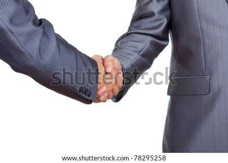 Two caucasian businessmen standing in elegant suits handshake isolated on white background, with empty copy space. Communication, greeting, agree, congratulation meeting concept. - stock photo