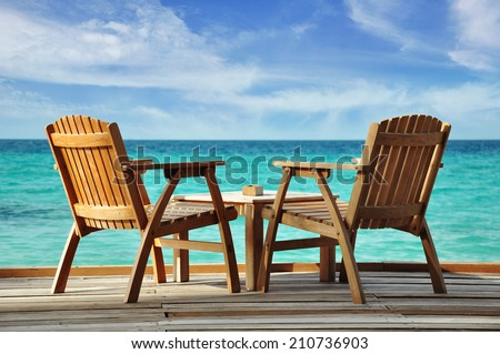two chairs at the water - stock photo