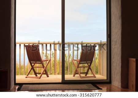 Two chairs on holiday villa terrace - stock photo