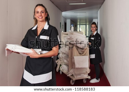 Two chambermaid women cleaning in a hotel. - stock photo
