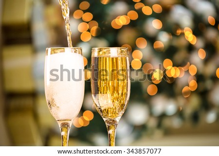 Two Champagne Glass On Defocused Background Living Room With Christmas Tree - stock photo