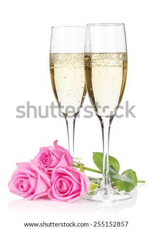 Two champagne glasses and pink rose flowers. Isolated on white background - stock photo