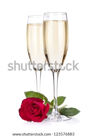 Two champagne glasses and rose. Isolated on white background - stock photo