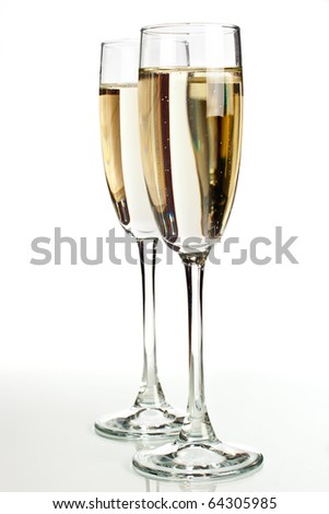 Two champagne glasses isolated on white background - stock photo