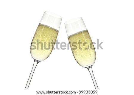 Two champagne glasses on a white background - stock photo