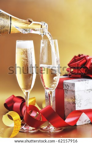 two champagne glasses on celebratory table - stock photo