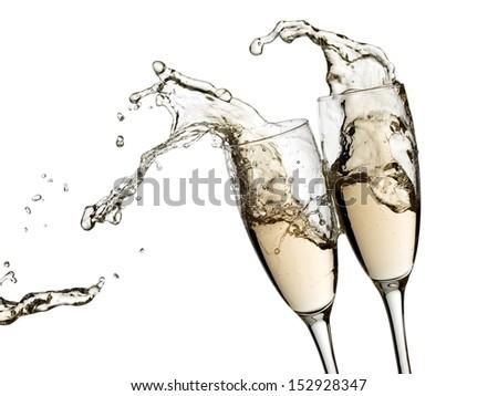Two champagne glasses splash - stock photo