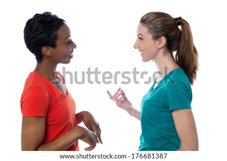 Two charming friends discussing something - stock photo