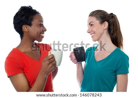 Two charming friends enjoying coffee - stock photo