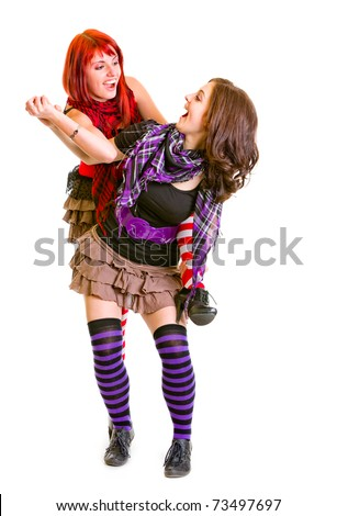 Two cheerful girlfriends  funny posing together isolated on white - stock photo