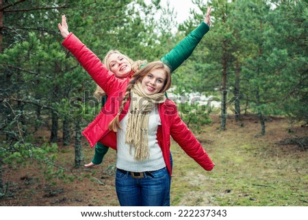 Two cheerful women on the nature - stock photo