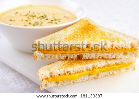 Two cheese sandwiches with a bowl of soup - stock photo