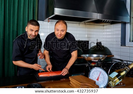 Two chefs at work in a restaurant. Chef,cook,job. - stock photo