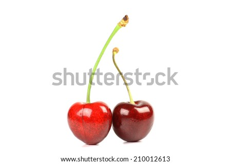 Two cherries in love - stock photo