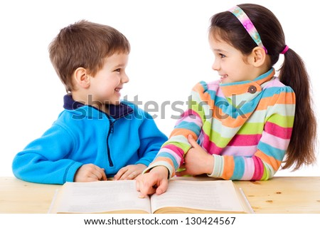 Two children are discussed about read book, isolated on white - stock photo