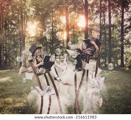 Two children are reading books on long, surreal chairs in the woods with smoke underneath with bubbles in the air for an education or imagination concept. - stock photo