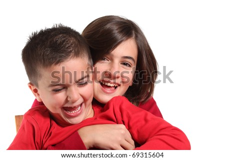 Two Children hugging isolated on white - stock photo