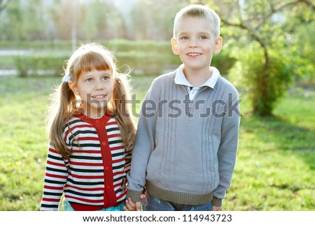 Two children  in park together - stock photo