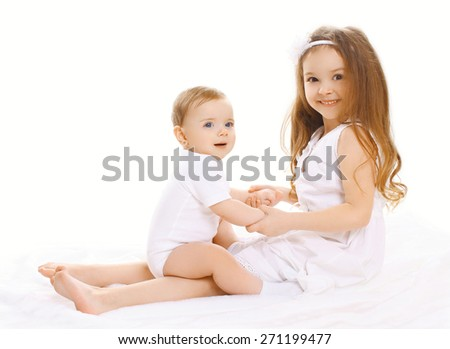 Two children little sisters playing and having fun together - stock photo