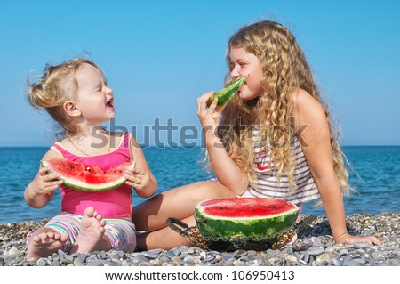 two children of the sea with watermelon - stock photo