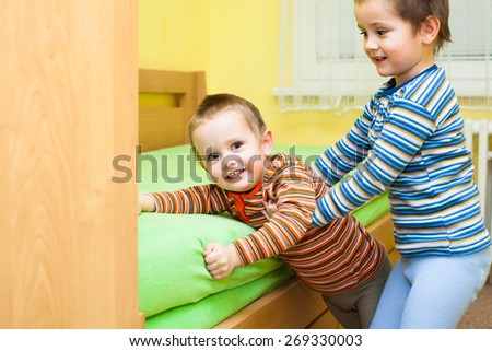 Two children playing together and having fun at home - stock photo