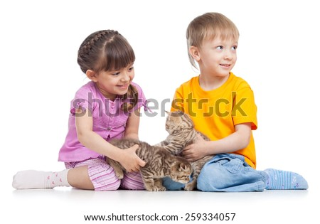 two children playing with kitten isolated on white - stock photo