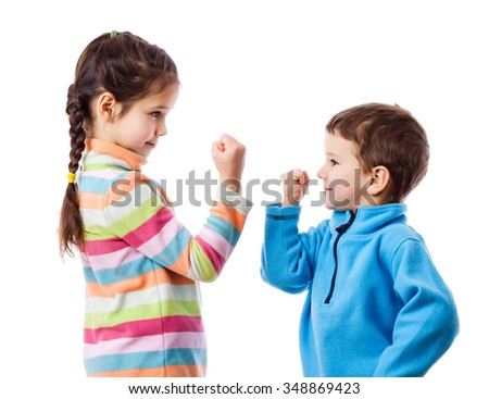 Two children threaten each other a fist, mutual relations concept, isolated on white - stock photo