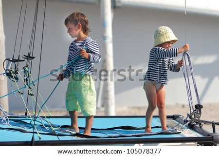 two children traveling on sea yacht - stock photo