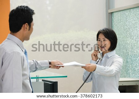 Two Chinese office workers - stock photo