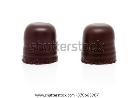 two chocolate covered marshmallows, isolated on white background with clipping path - stock photo