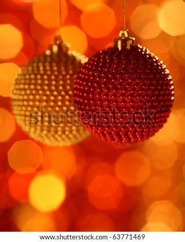 Two Christmas ball against blurred background - stock photo
