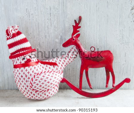Two Christmas Decoration, A Robin and A Deer, On A Wooden Shelve - stock photo