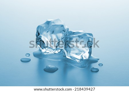 two chunks of ice cubes are melting - stock photo