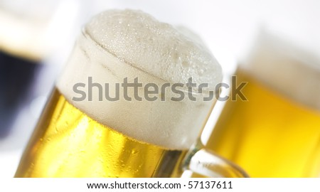two circles of light and dark beer - stock photo