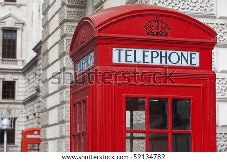 Two classic red London Telephone boxes, in the City of Westminster, London, England, Great Britain - stock photo