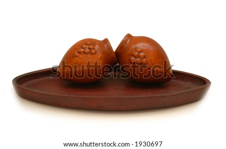 Two clay pots in the plate isolated on white - stock photo
