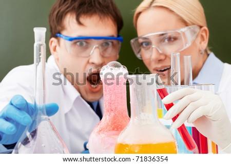 Two clinicians making scientific experiment in laboratory - stock photo