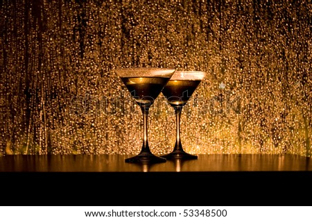 Two cocktail glasses on the table - stock photo