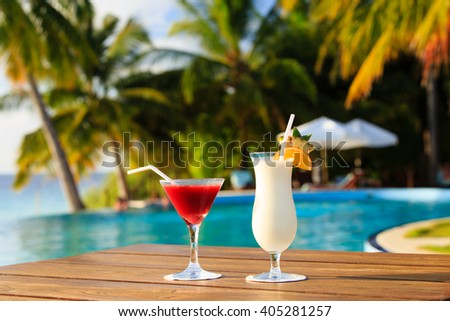 Two cocktails on luxury tropical beach - stock photo
