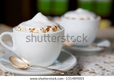 two coffee cups at the restaurant or cafe - stock photo