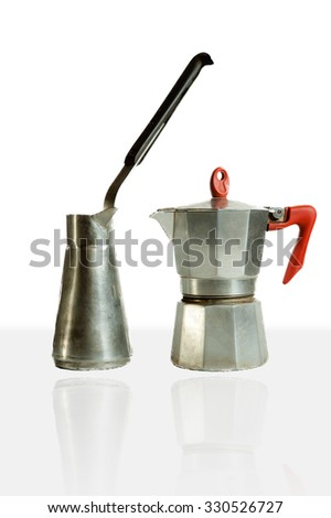 Two coffeemakers stainless steel and aluminum, one for cooking on the fire second geyser type - stock photo