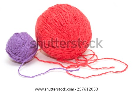 two coil woolen threads on a white background - stock photo
