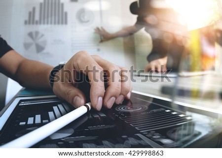 two colleague web  designer discussing data and digital tablet and computer laptop with smart phone and design diagram on wooden desk as concept - stock photo